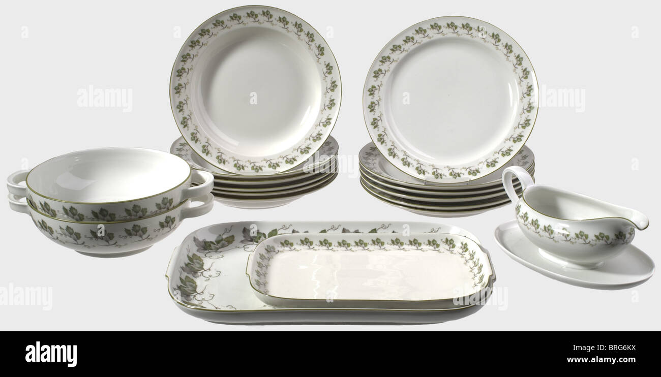 A table service with grape leaf decoration, Allach Porcelain Factory White, glazed porcelain with hand painted grape - Stock Image