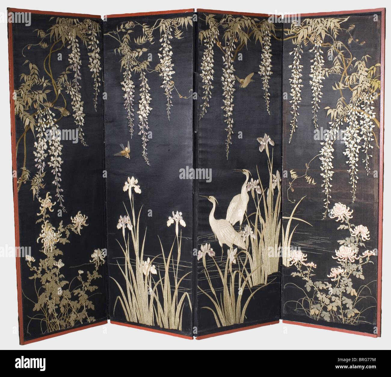 A Japanese folding screen (byobu), Meiji period Four-panel folding screen, the panels covered with black atlas silk. - Stock Image