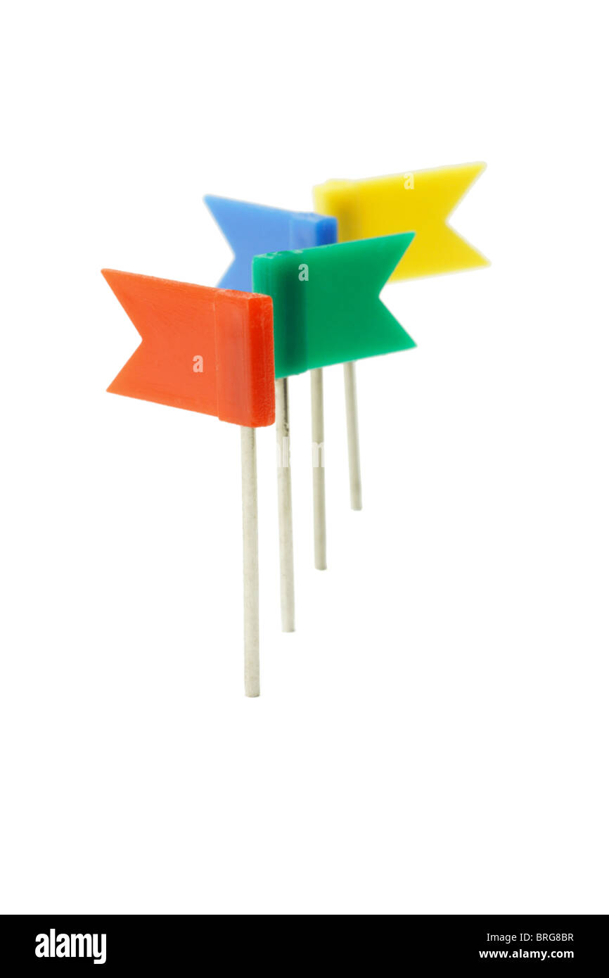 Multicolor plastic flag pins in a row on white background - Stock Image