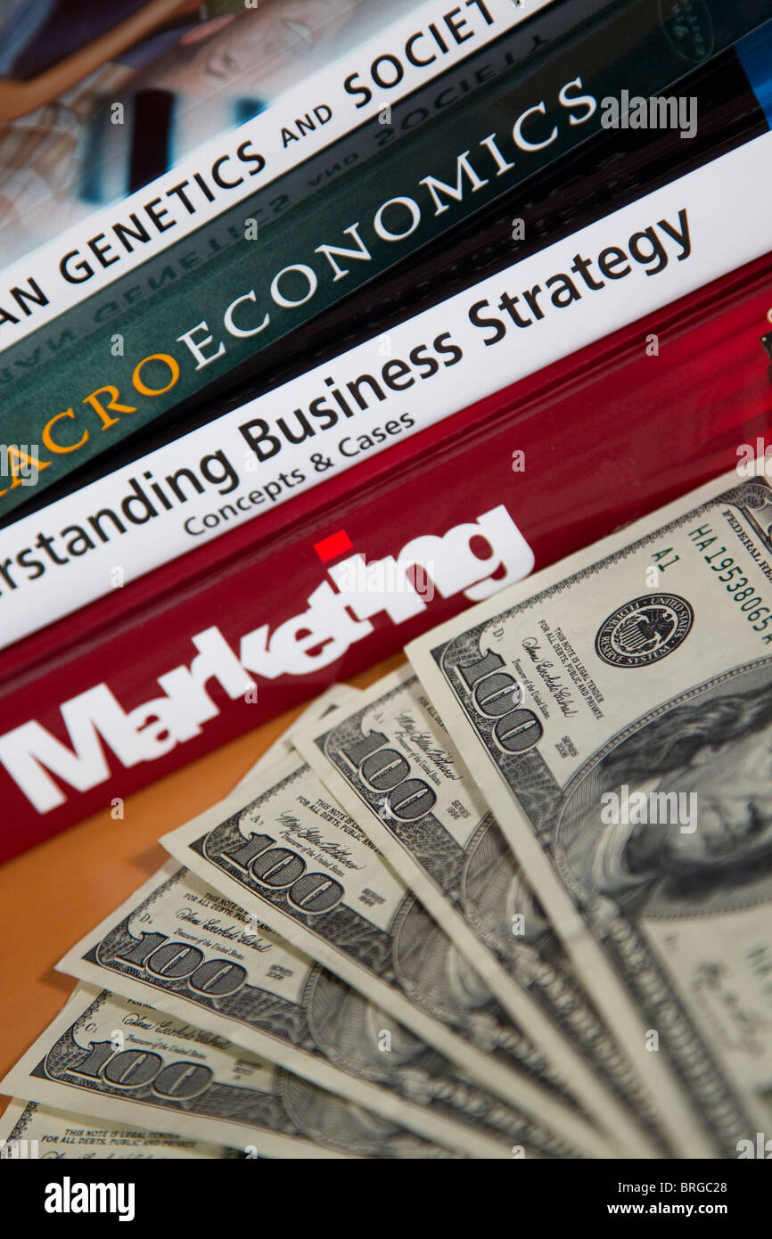 Money, textbooks tuition and fees for college degree - Stock Image
