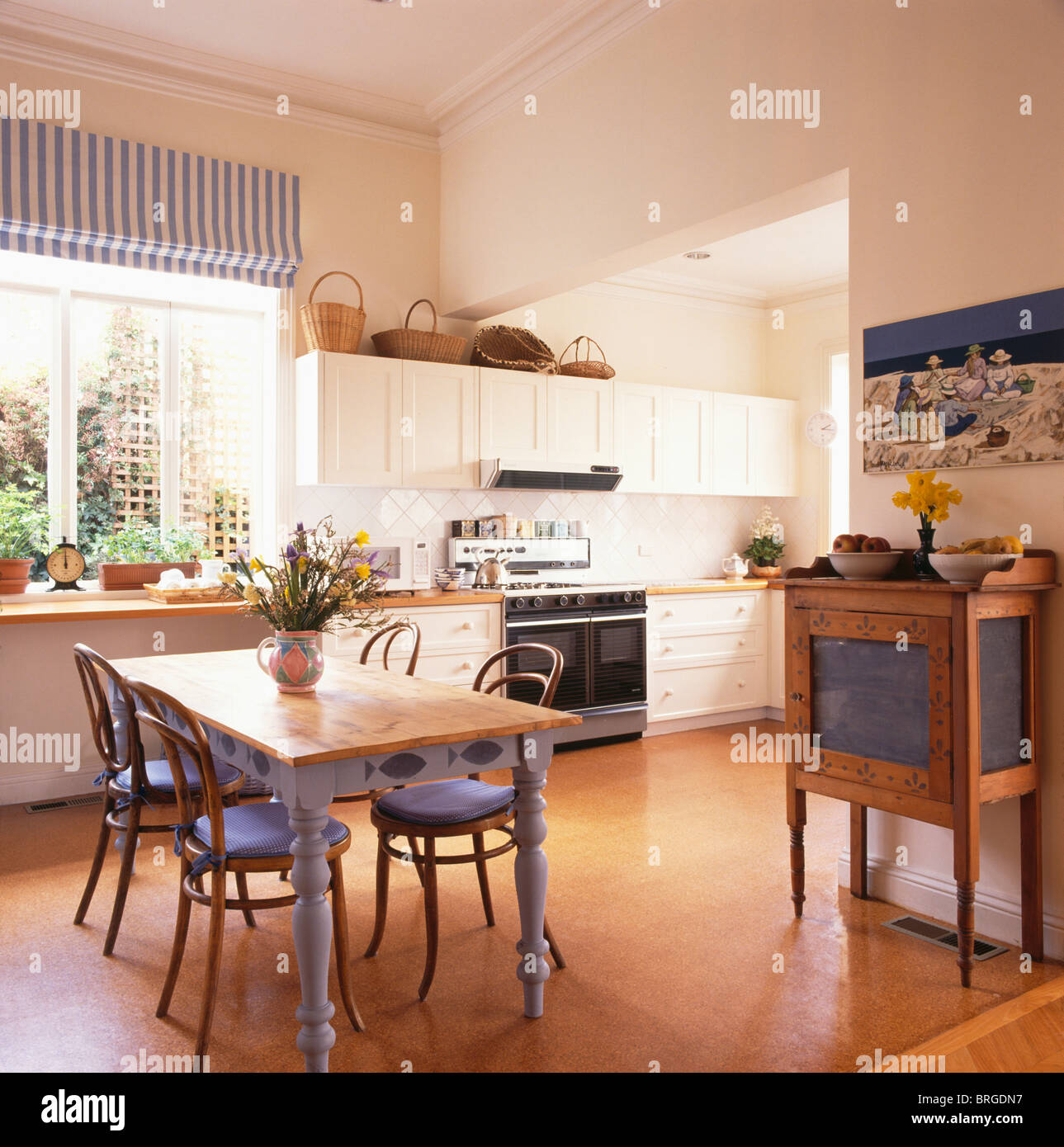 Cork Flooring In Modern Kitchen Dining Room With Bentwood Chairs With Blue  Cushions And Old Painted Pine Table Table