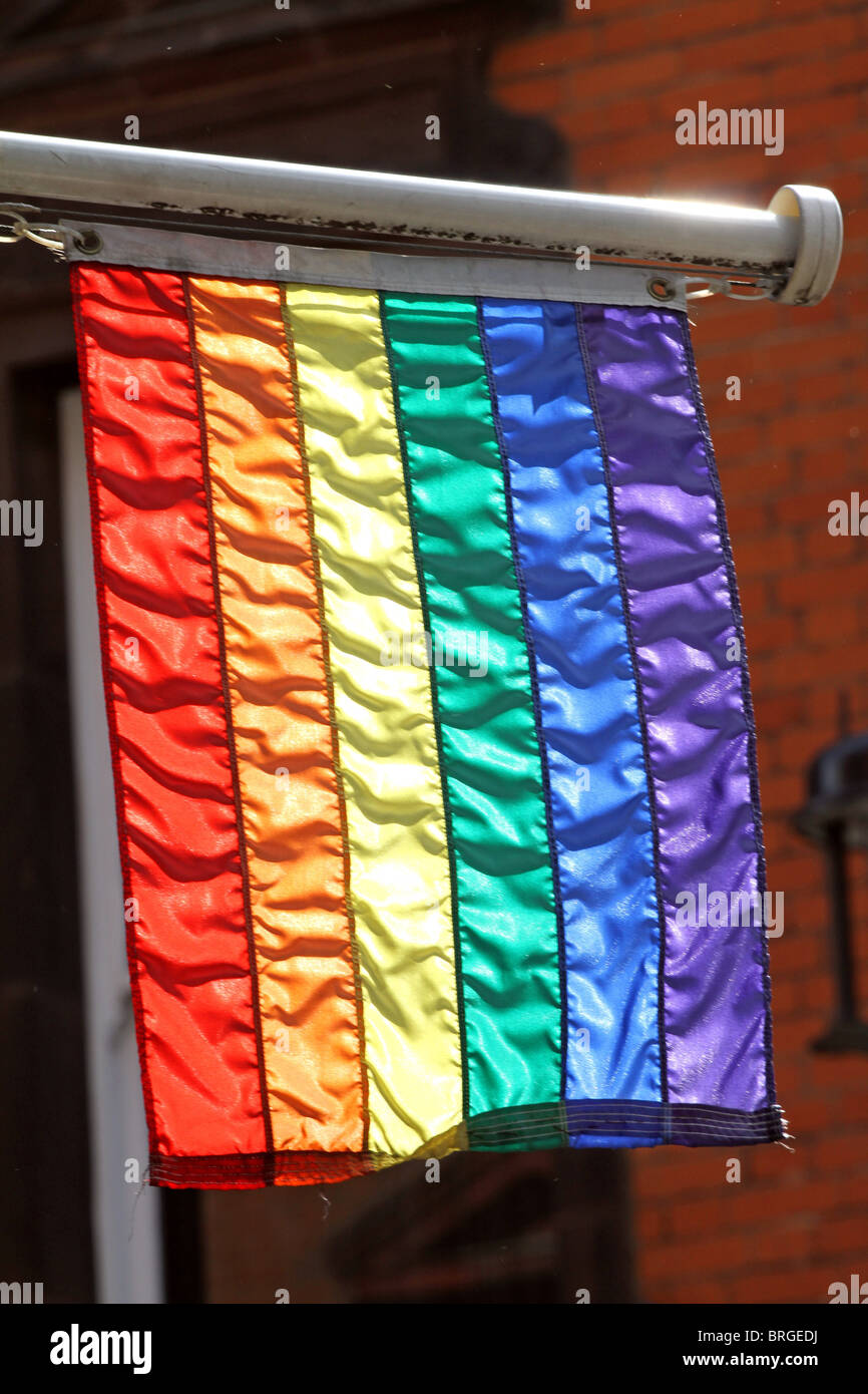 Gay rainbow flag in the gay village in Soho, London, England - Stock Image