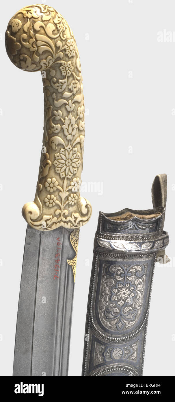 A Caucasian khanjar with ivory grip, circa 1900 Blade of wootz Damascus, chiselled and inlaid with gold on both Stock Photo