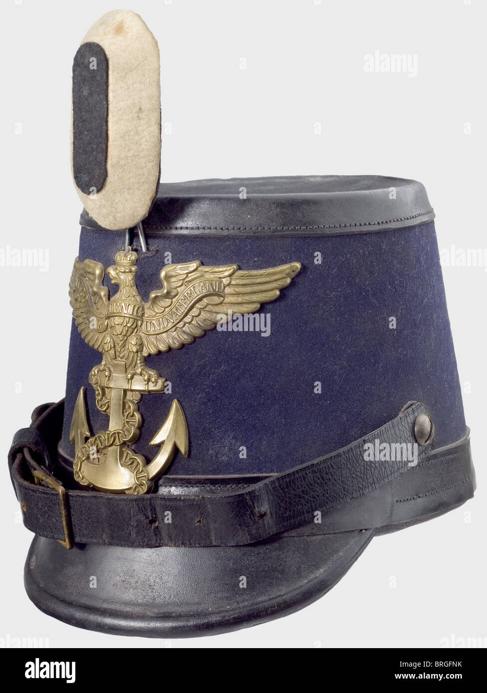A shako for enlisted men of the Sea Bataillon (marines), of the Prussian Navy Dark blue felt body with black leather - Stock Image