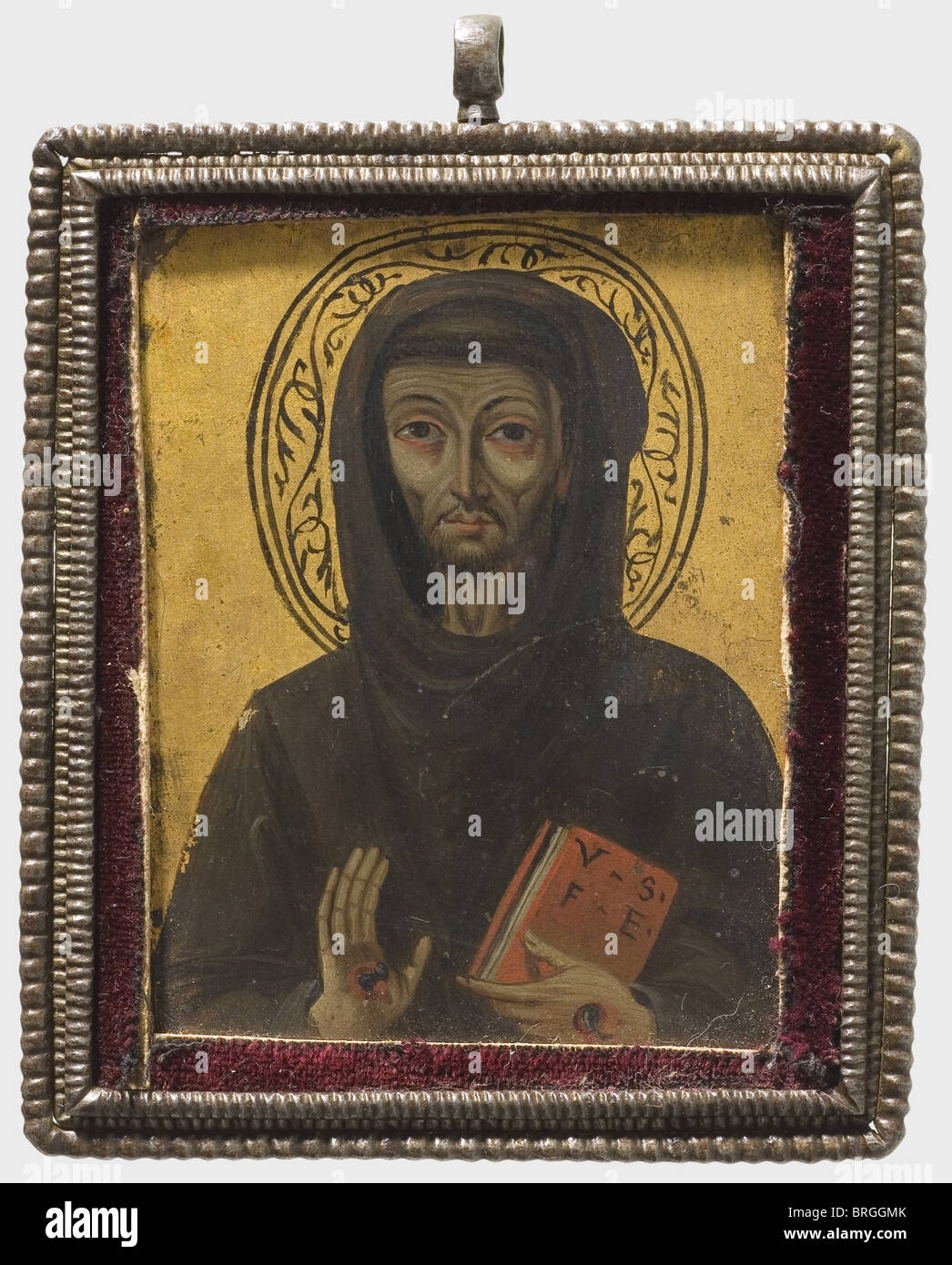 A French miniature painting of St. Francis, 2nd half of the 15th century Oil on gilded copper. A half portrait of - Stock Image