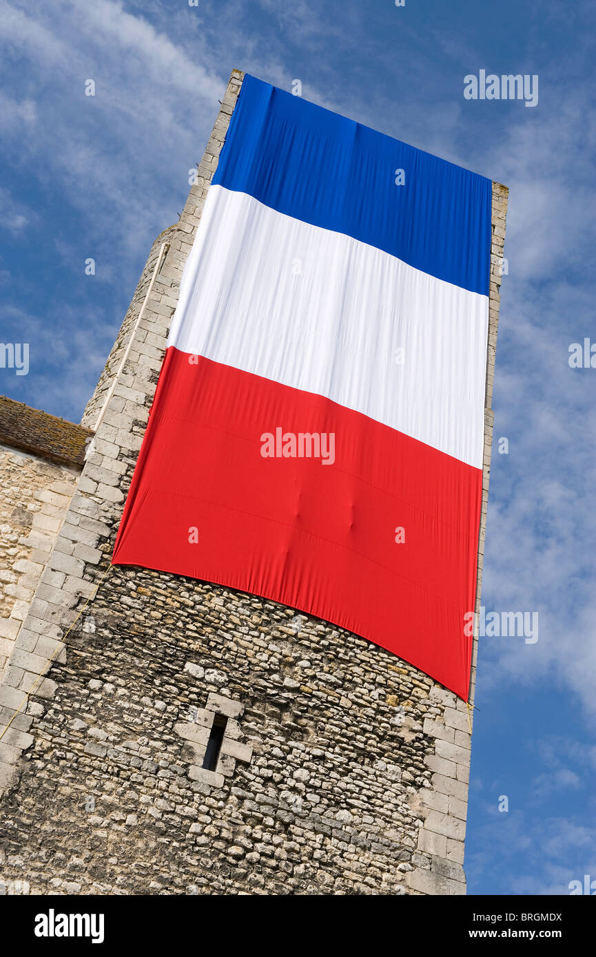 french flag draped over medieval castle tower, nemours, france - Stock Image