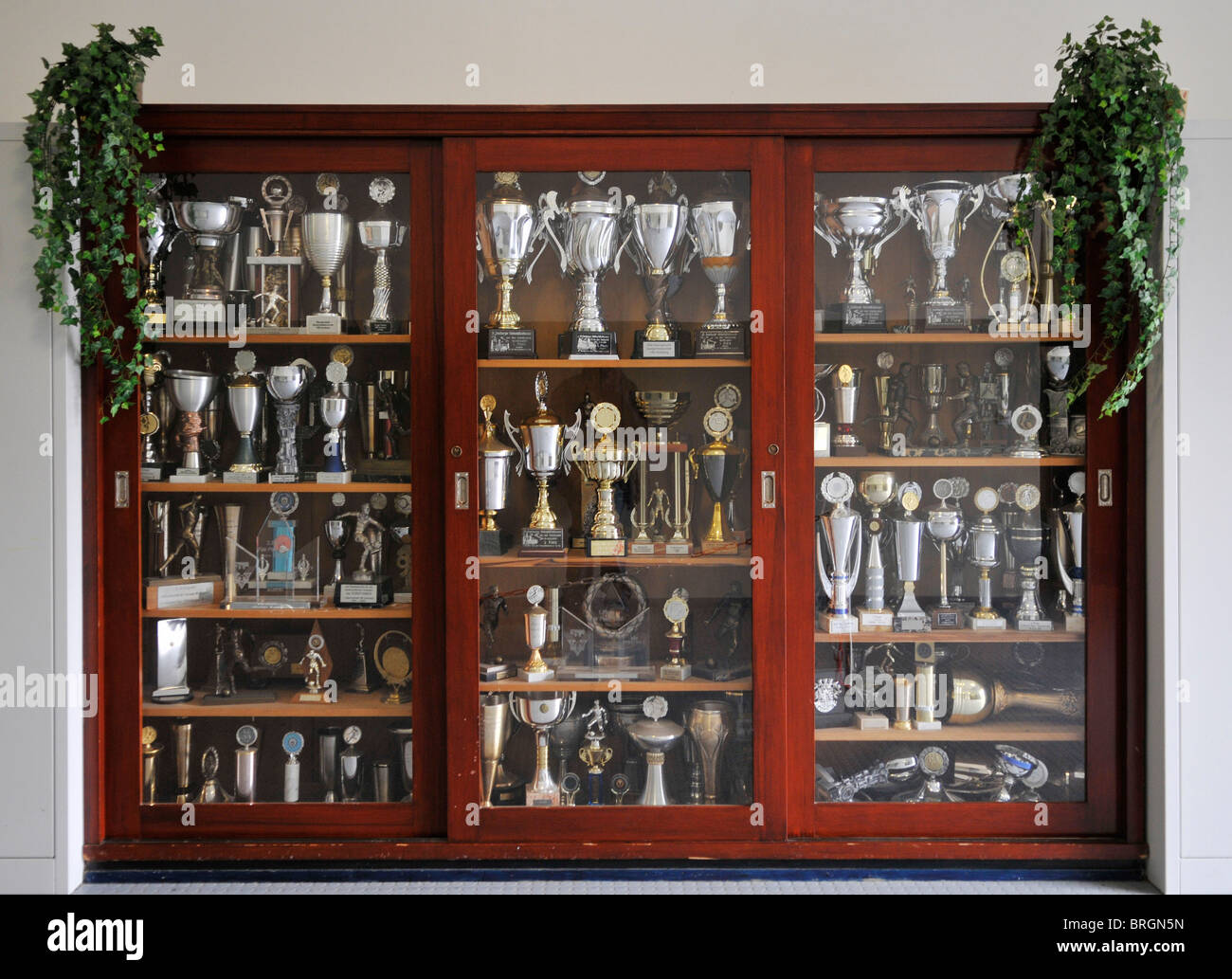 Cabinet Filled With Football Trophies In Home Of German Soccer Club