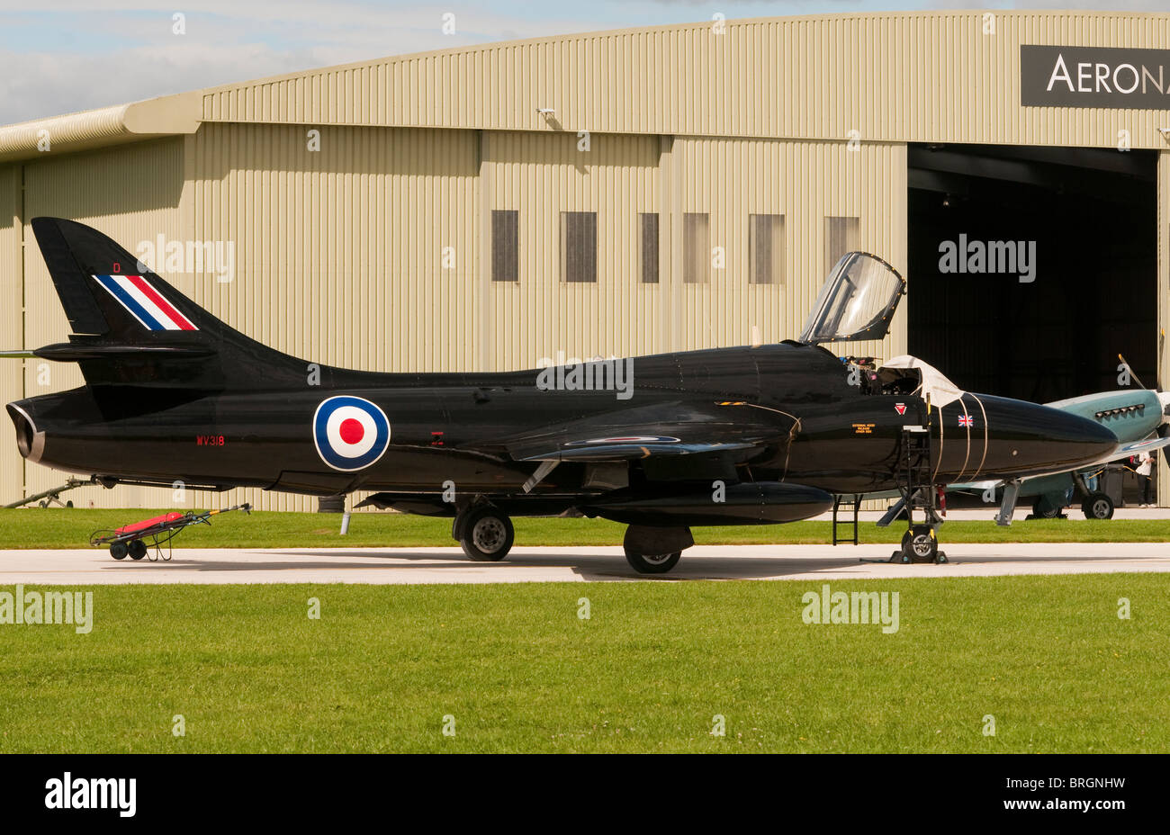 Hawker Hunter jet aircraft outside a hangar at Kemble cotswolds Airport on Battle of Britain Day 2011 - Stock Image