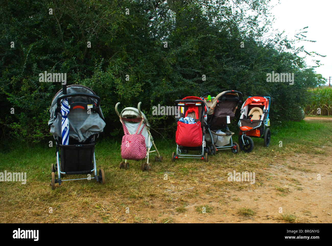 Empty baby carriages outside - Stock Image
