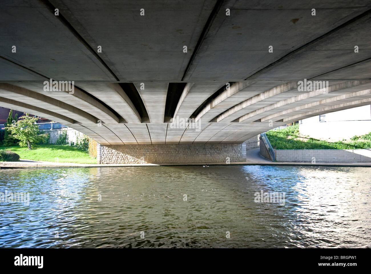 Underneath a river bridge - Stock Image