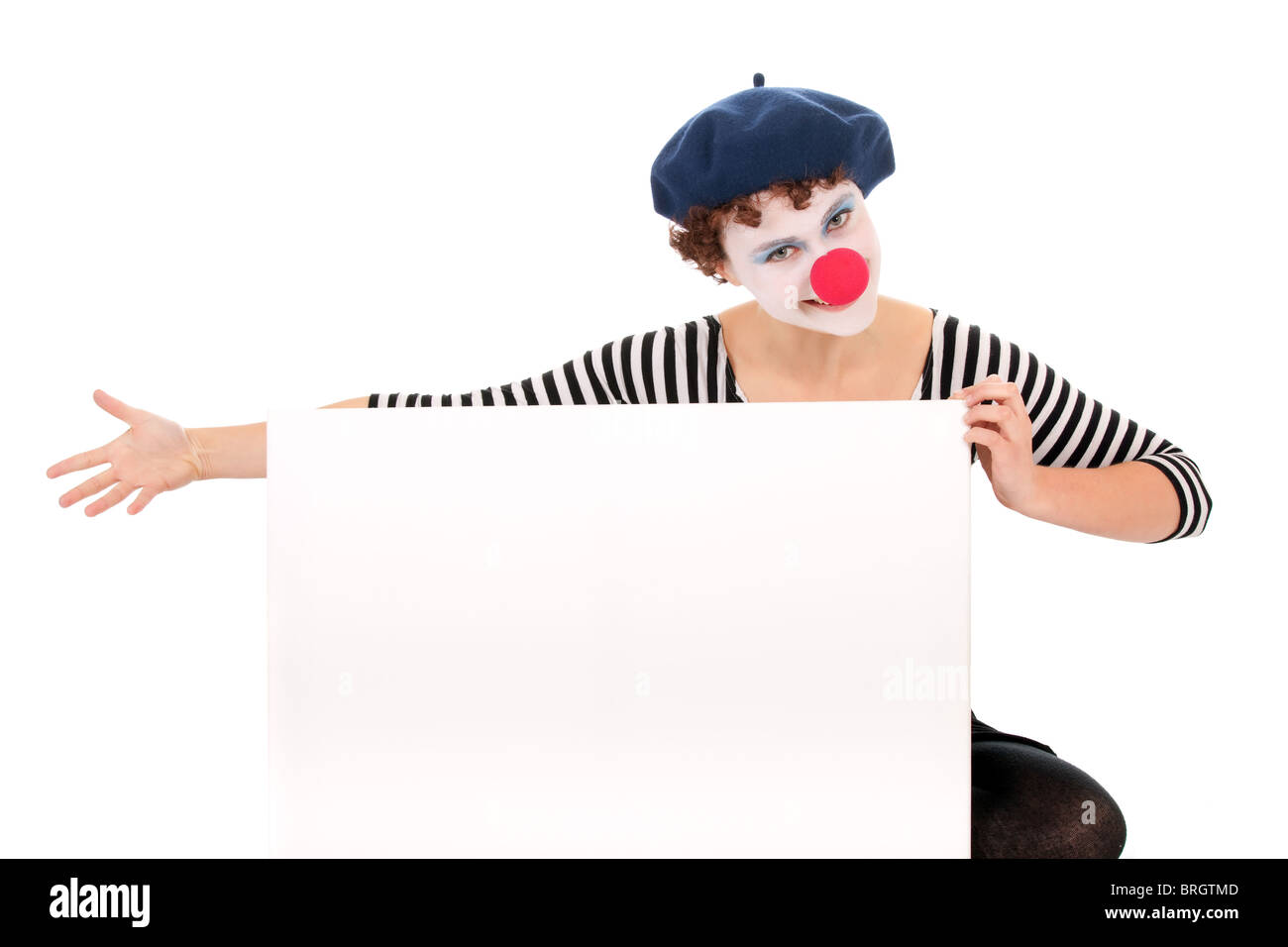 pretty clown woman holding blank billboard isolated on white background - Stock Image