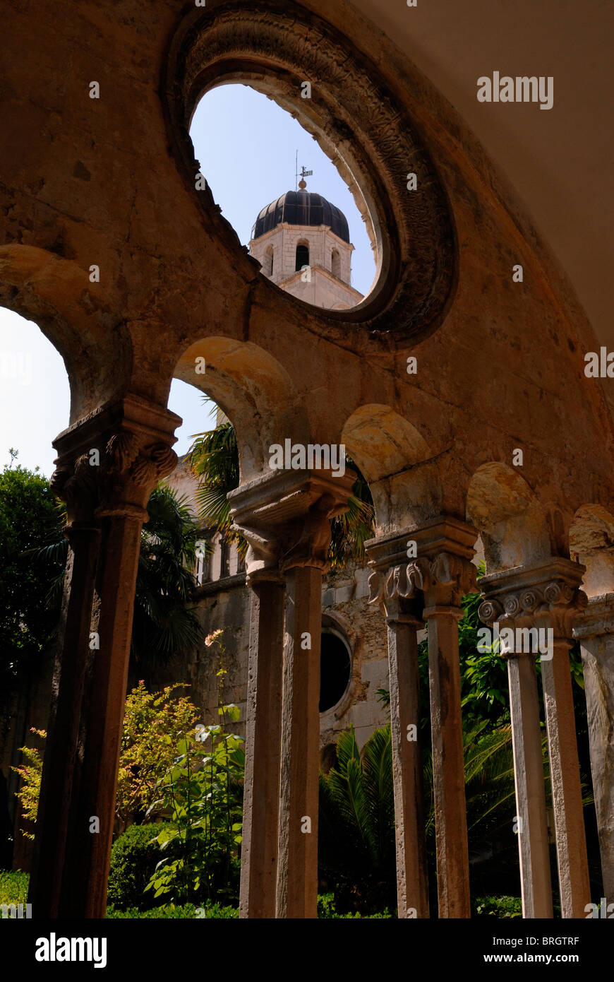 A fine view from Franciscan Cloister to the bell tower of the Franciscan Monastery. Construction of the Monastery Stock Photo