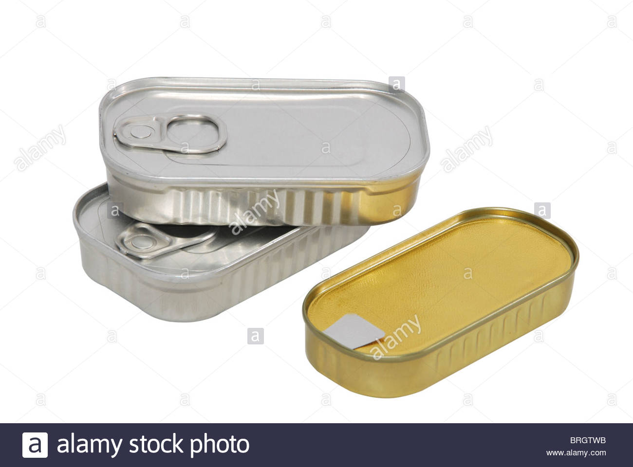 Three tin cans closed isolated over white. Food packaging - Stock Image