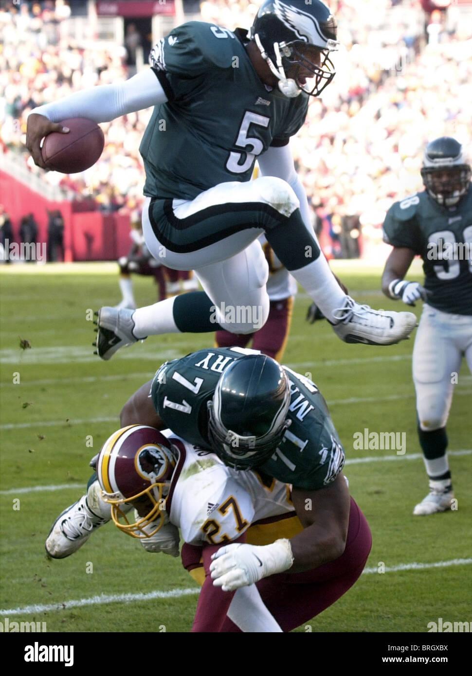 f51aaafa001 Philadelphia Eagles' Donovan McNabb (5) jumps over Eagles' Jermane Mayberry  (71