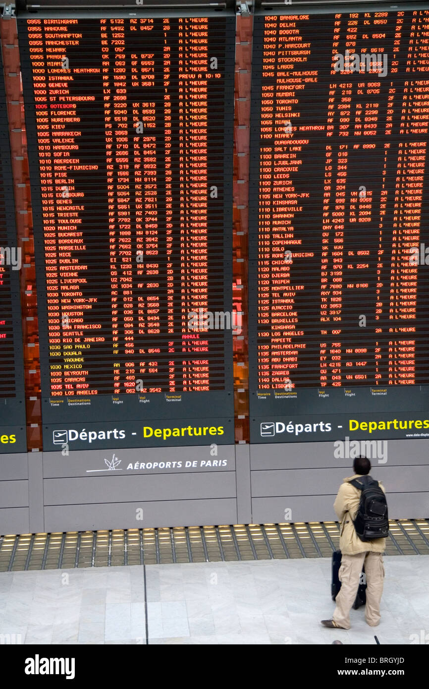 Departure board located in the Paris-Charles de Gaulle Airport, Paris, France. - Stock Image