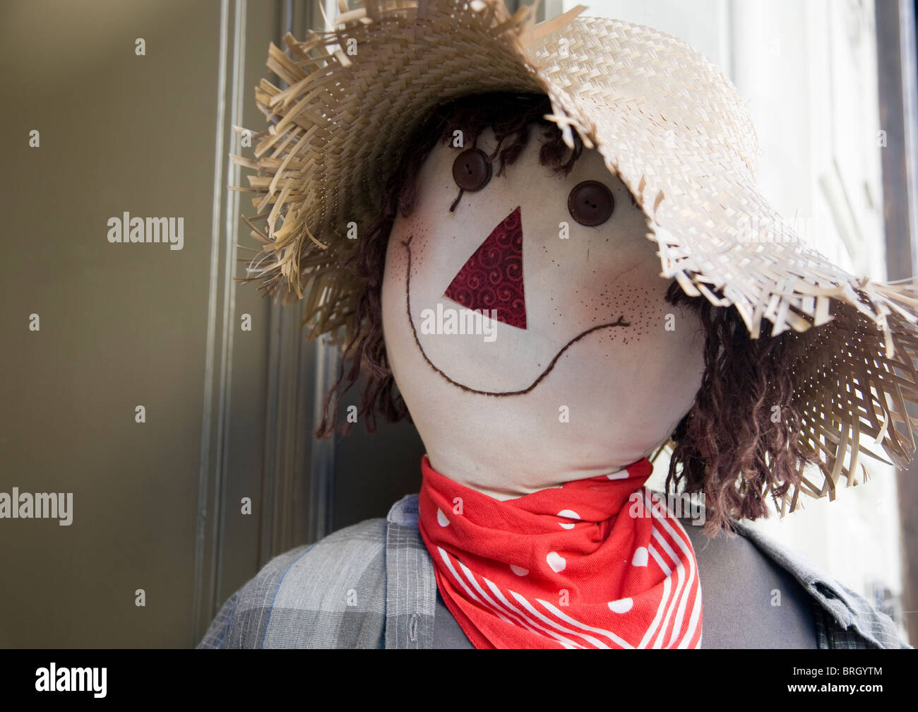 A rag doll puppet in a straw hat - Stock Image