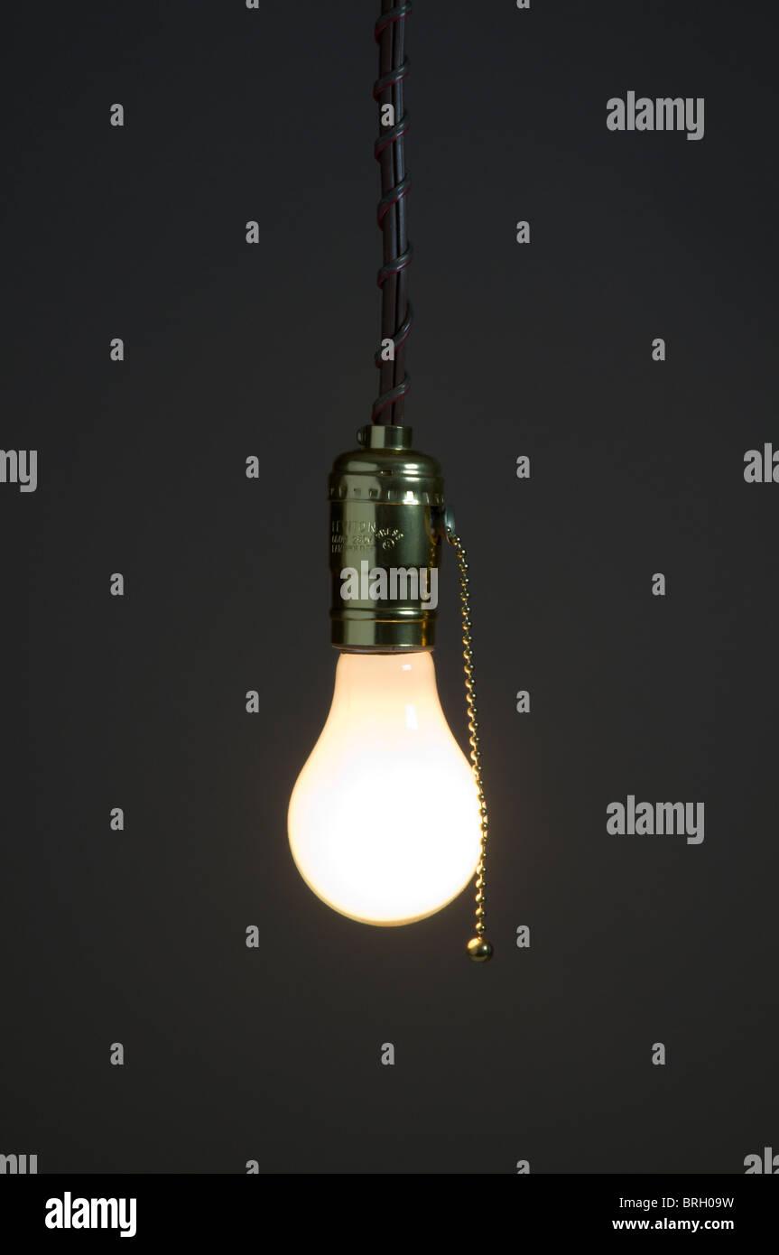 Hanging light bulb - Stock Image