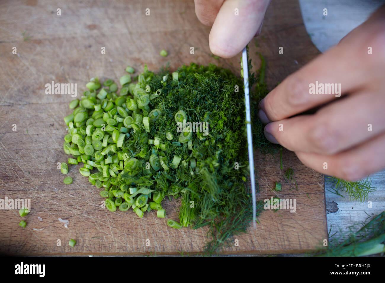 ©John Angerson Gabriel David prepares pasta con le sarde. - Stock Image