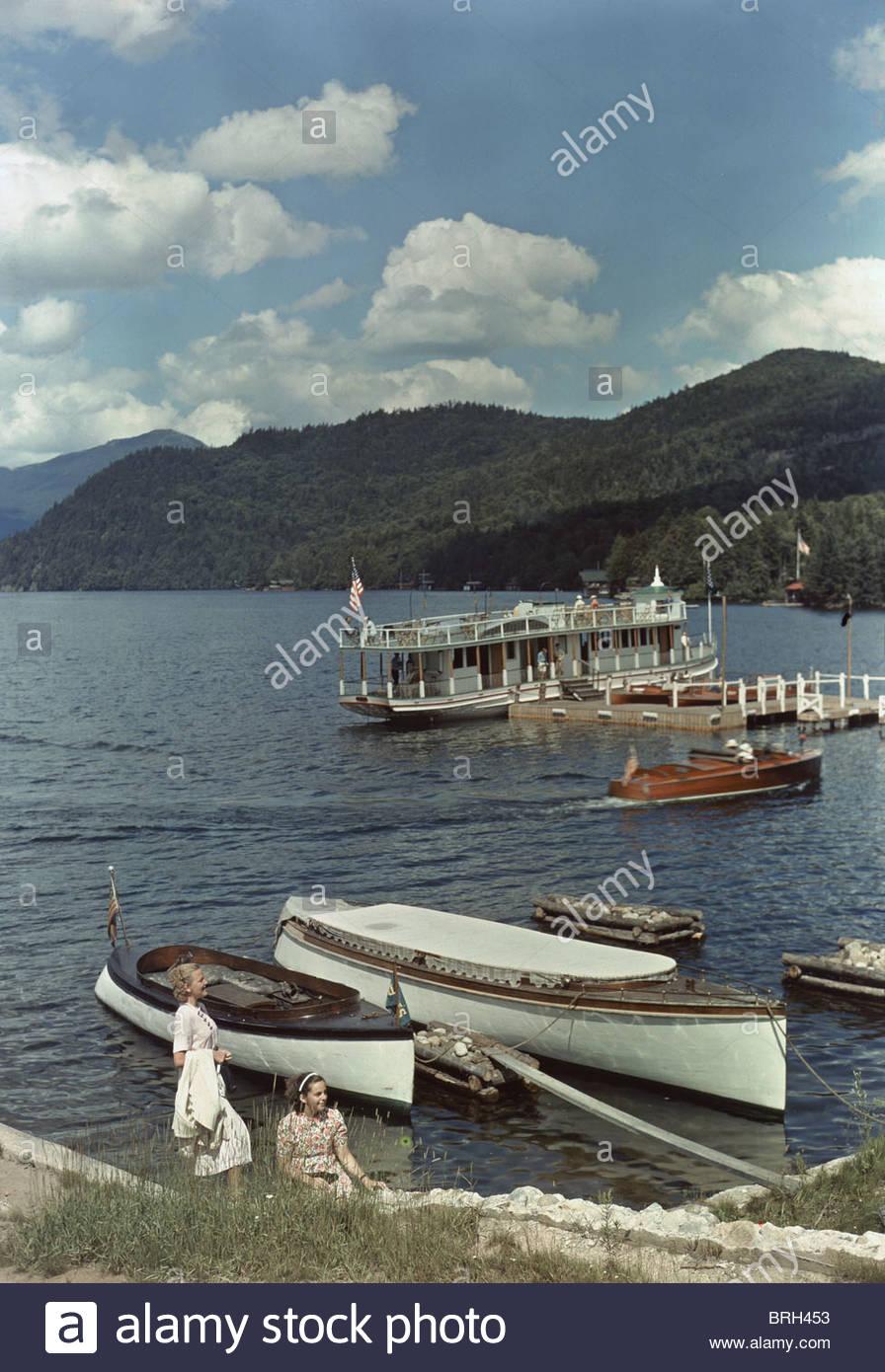 Visitors come to Lake Placid year-round to swim, ski, or skate. - Stock Image