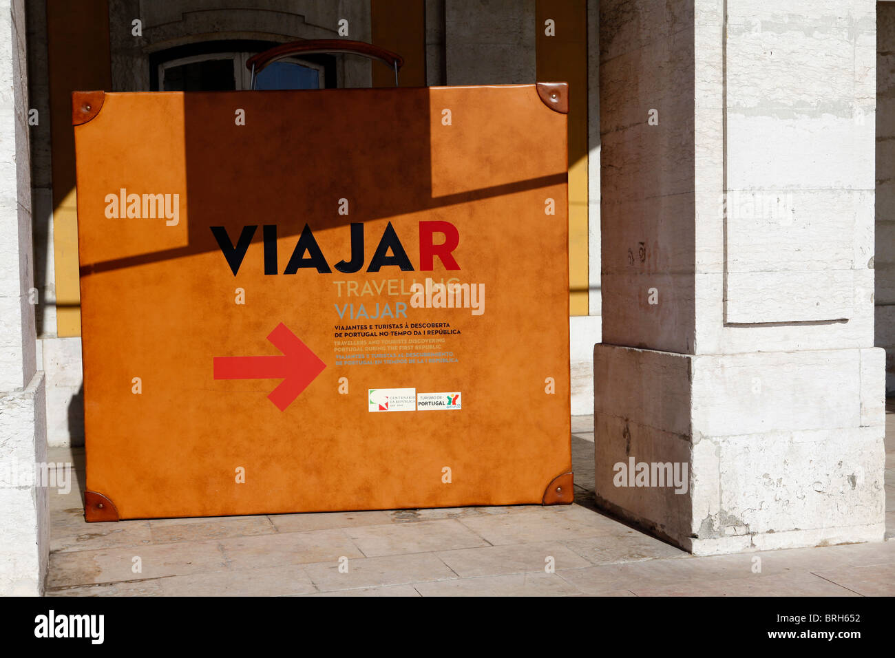 A suitcase advertises the Viajar (Travelling) exhibition in Lisbon, Portugal. - Stock Image