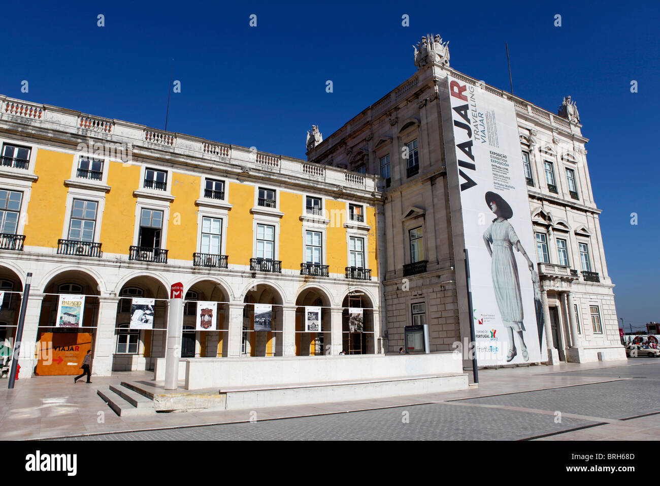 Advertising on one of the buildings of the Praca do Comercio for the Viajar (Travelling) exhibition in Lisbon, Portugal. - Stock Image