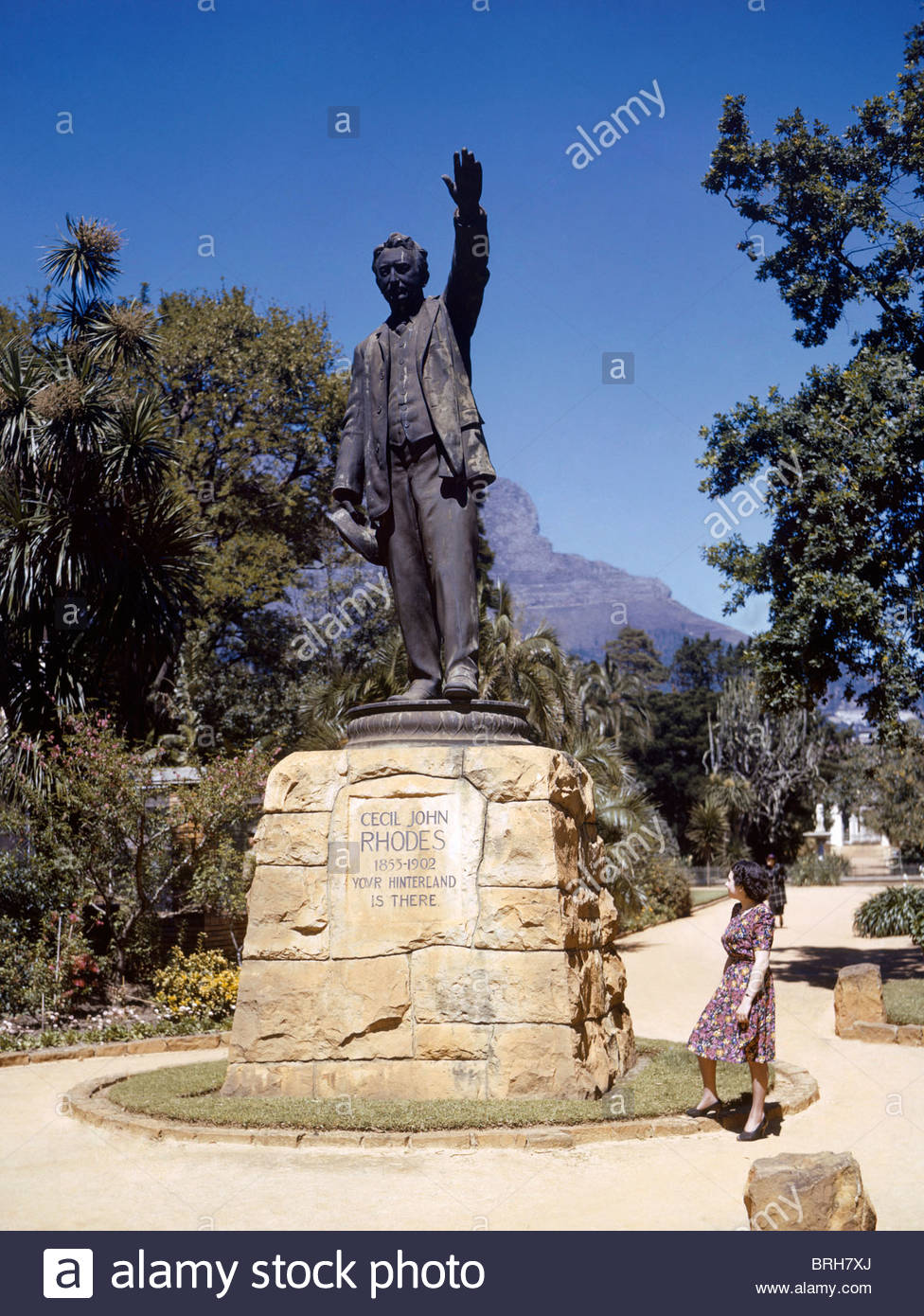 A woman looks up at a statue of Cecil John Rhodes. - Stock Image
