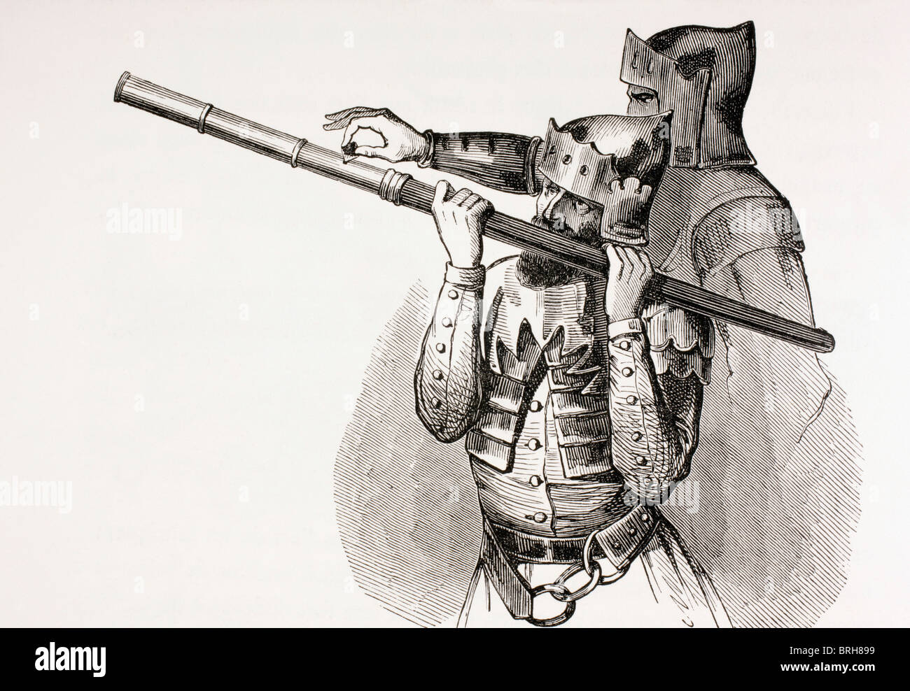 Two 15th century soldiers with a hand gun or firing baton. - Stock Image