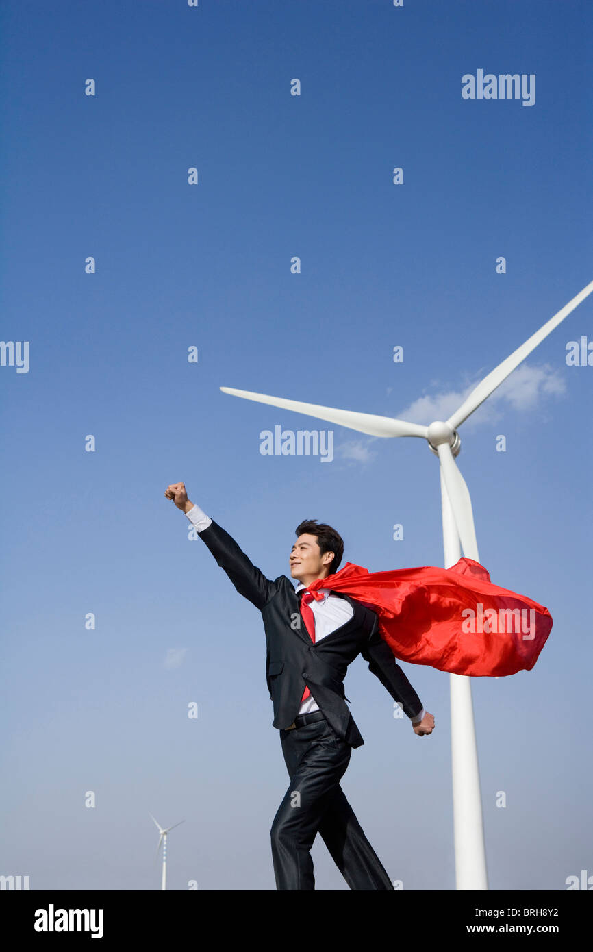 Everyday heroes in front of wind turbines - Stock Image