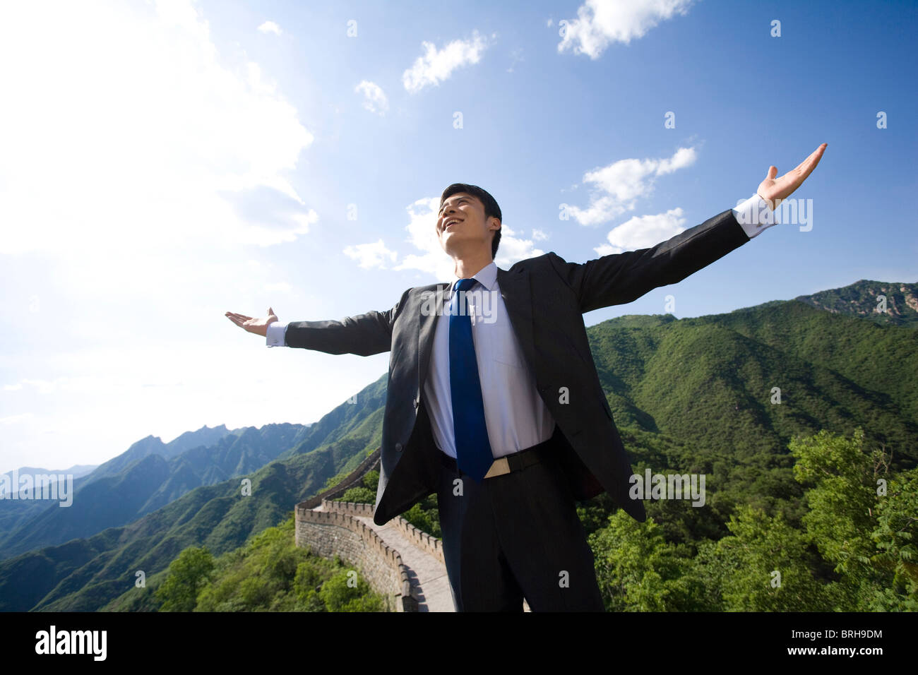 Businessman on the Great Wall - Stock Image