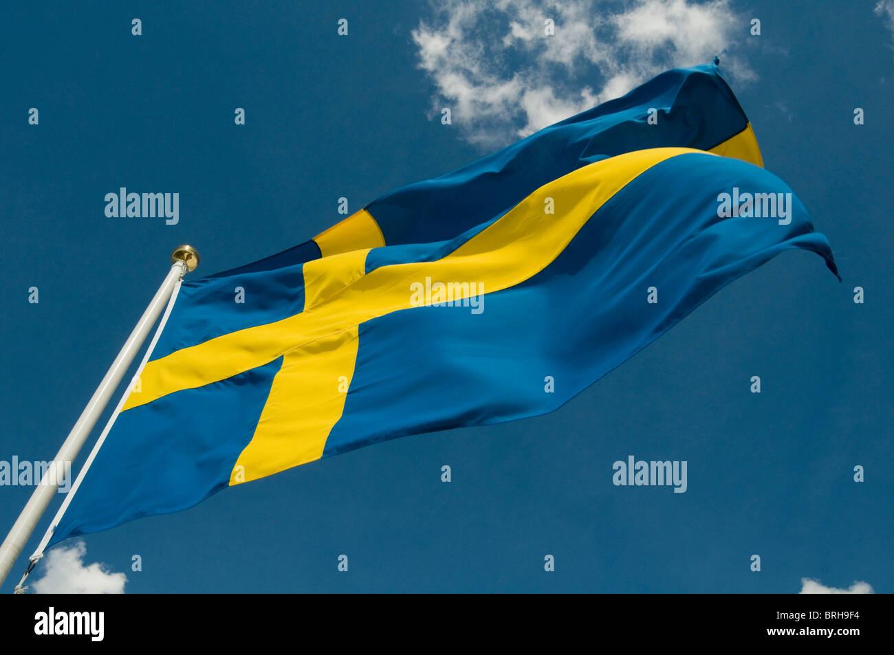 swedish flag sweden flags pole poles flagpole flagpoles flutter fluttering national pride symbol nationality - Stock Image