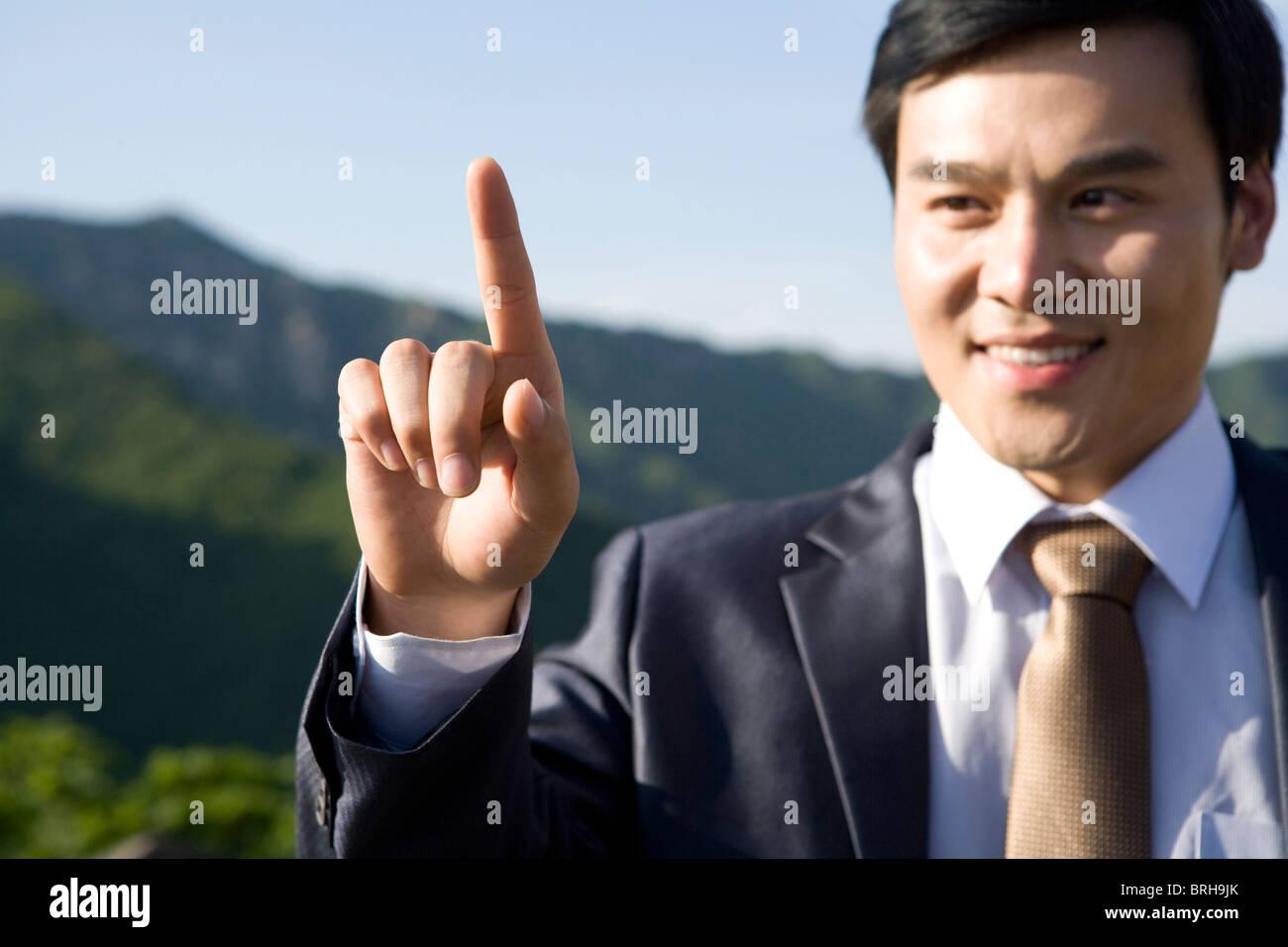 Businessman pointing - Stock Image