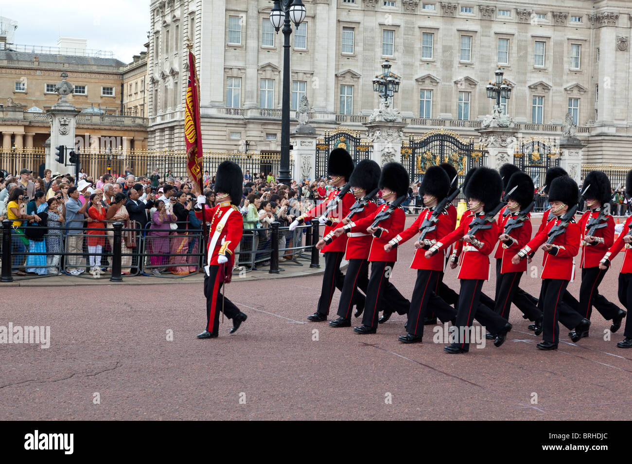 Queen's guardsmen march outside Buckingham Palace during    changing of the guard - Stock Image