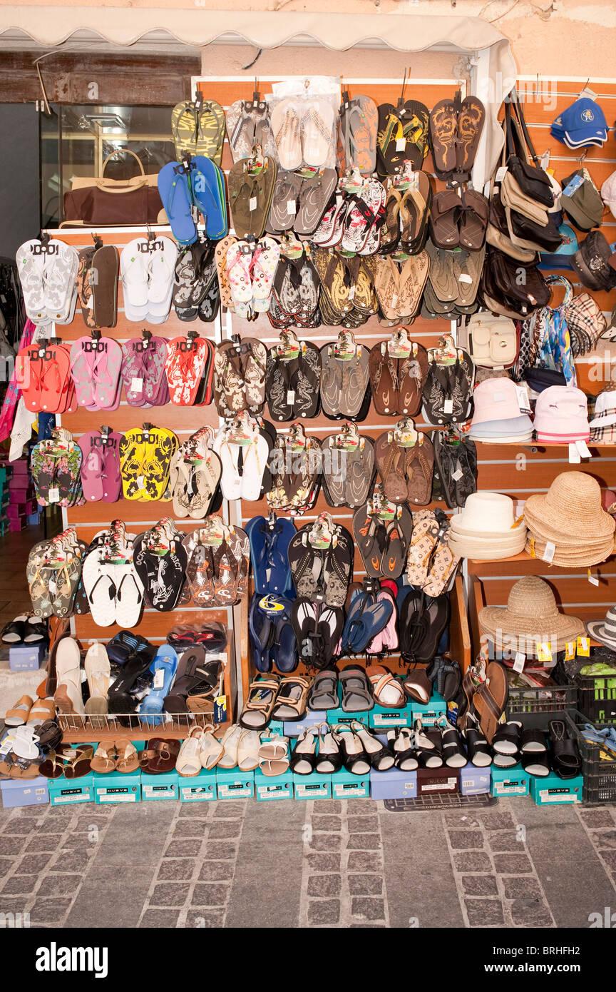 6629d064cb8d Flip flops sandals shoes and hats outside tourist shop Rethymno Crete Greece