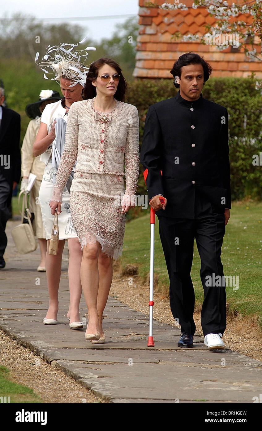 Liz Hurley & boyfriend at wedding of Sophia Burrell to Peter Thompson in Shipley, W.Sussex. - Stock Image