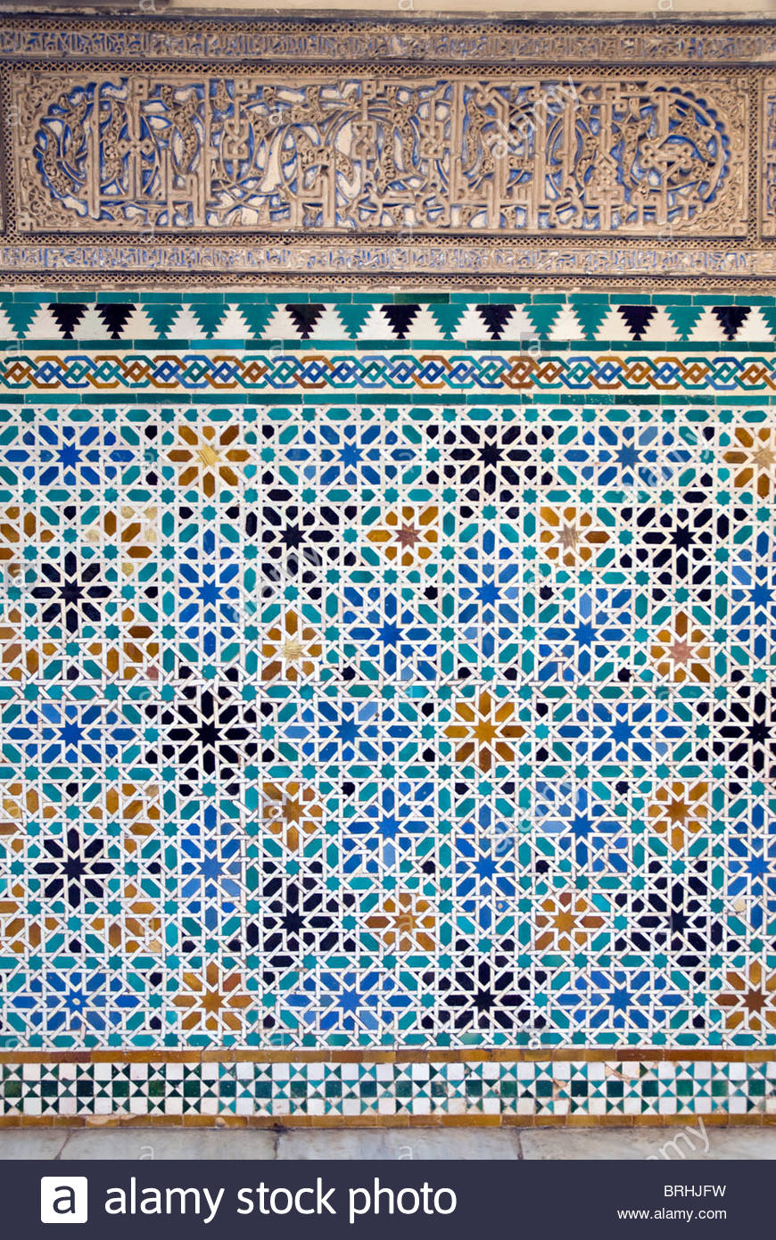 Detail of tiles and plaster carving at Alcazar Royal Palaces, Seville. Stock Photo