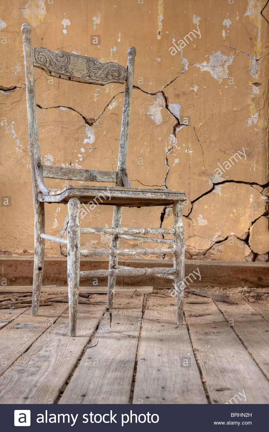 A wooden chair from yesteryear is preserved in a ghost mining town. - Stock Image