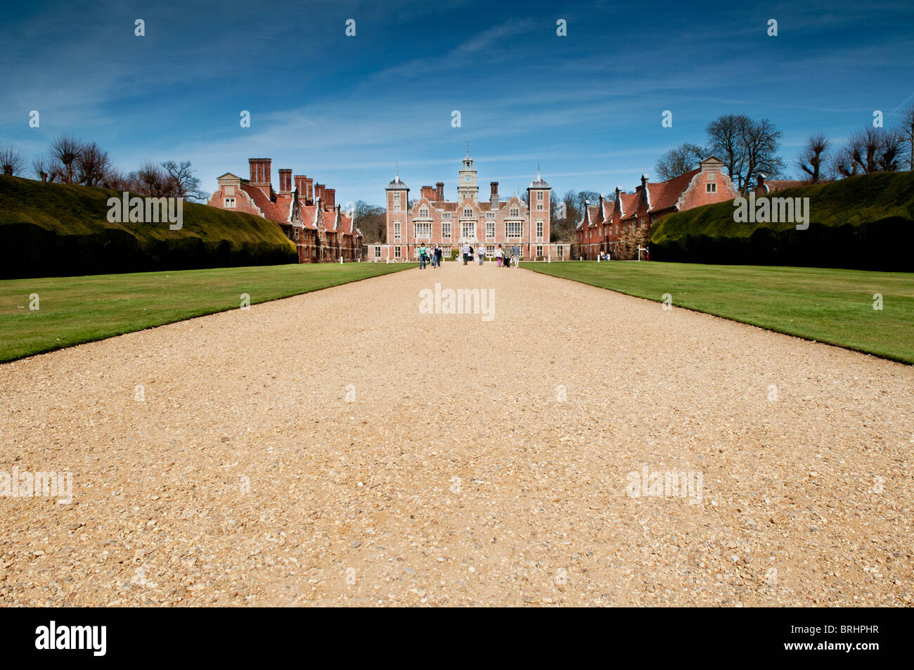 Landscape of Stately home with blue sky, green grass - Stock Image