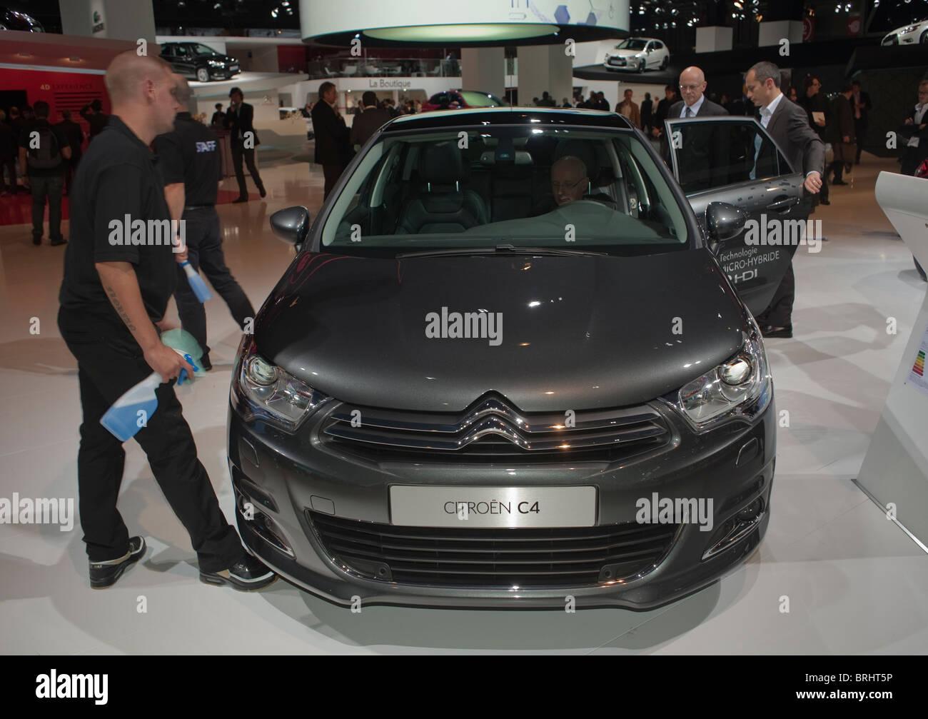 Paris, France, Paris Car Show, Citroen, French Hybrid Engine Car, C-Zero, Front, Man Cleaning Stock Photo