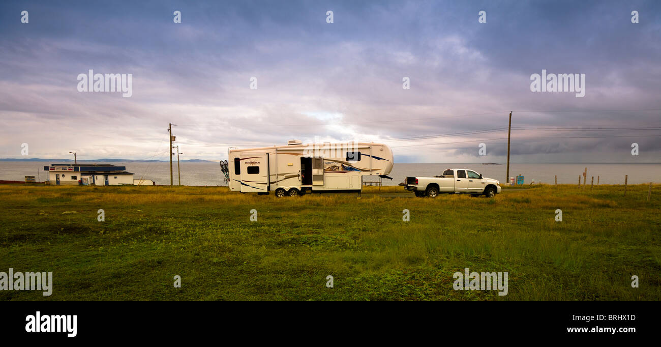 An RV camped on a lonely stretch of road on Cape Bonavista in Newfoundland, Canada. - Stock Image