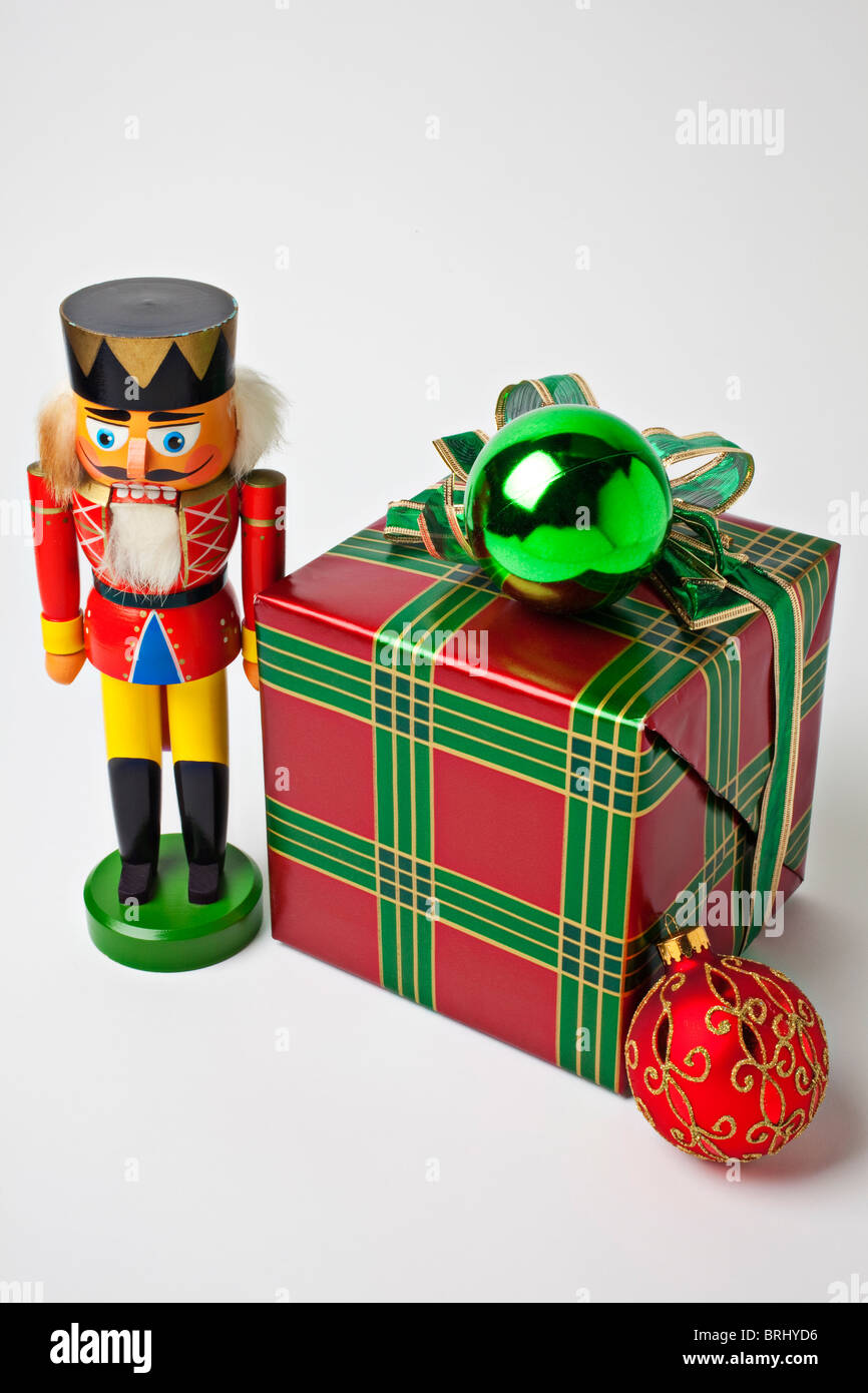 Nutcracker and Christmas present - Stock Image