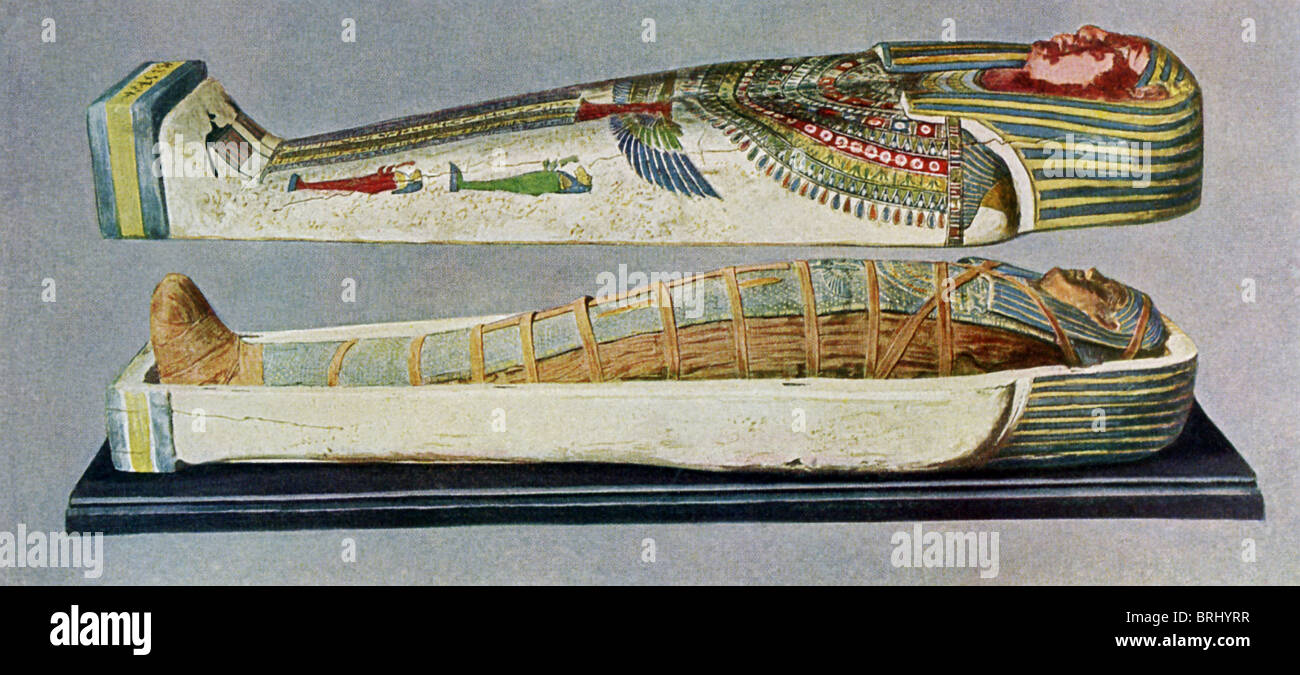 The sarcophagus is of a woman from Abusir, at a date later than the 20th Dynasty. The coffin lid is lifted to show - Stock Image