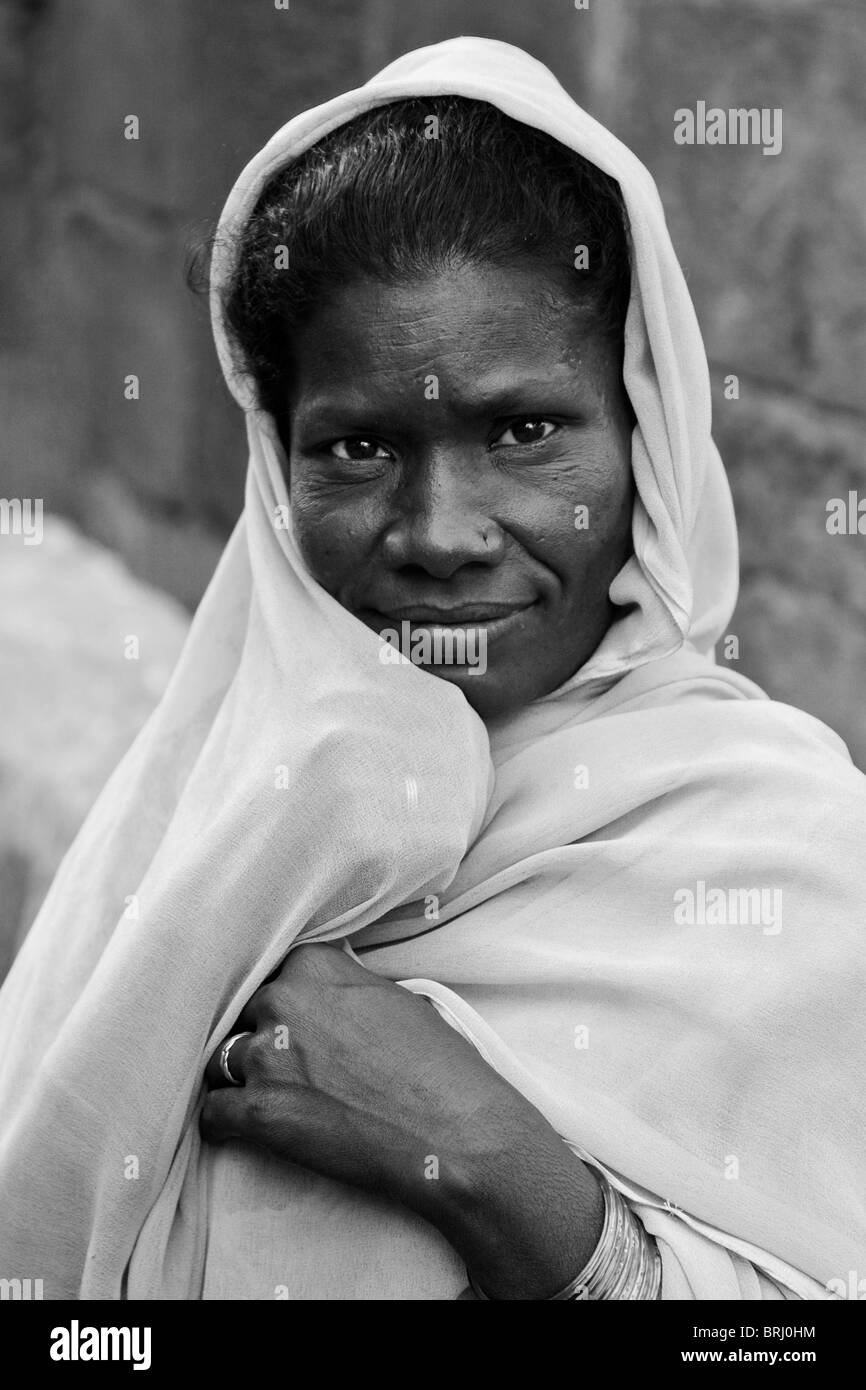 Indian Woman Covers Herself with a Veil, Ahmedabad, Gujarat India. Black & White. - Stock Image