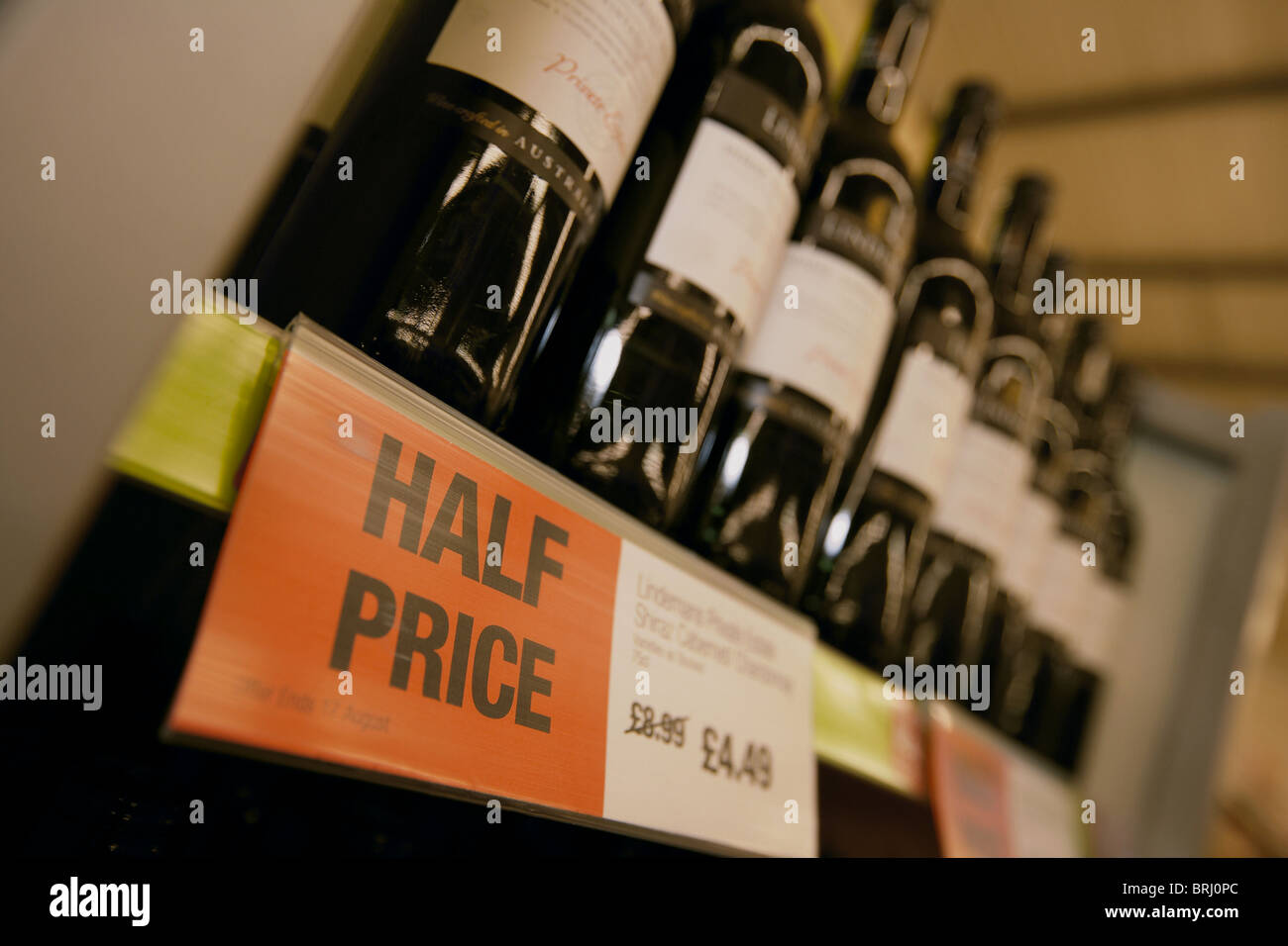 Cheap alcohol half price bottles of wine for sale in a supermarker, UK - Stock Image
