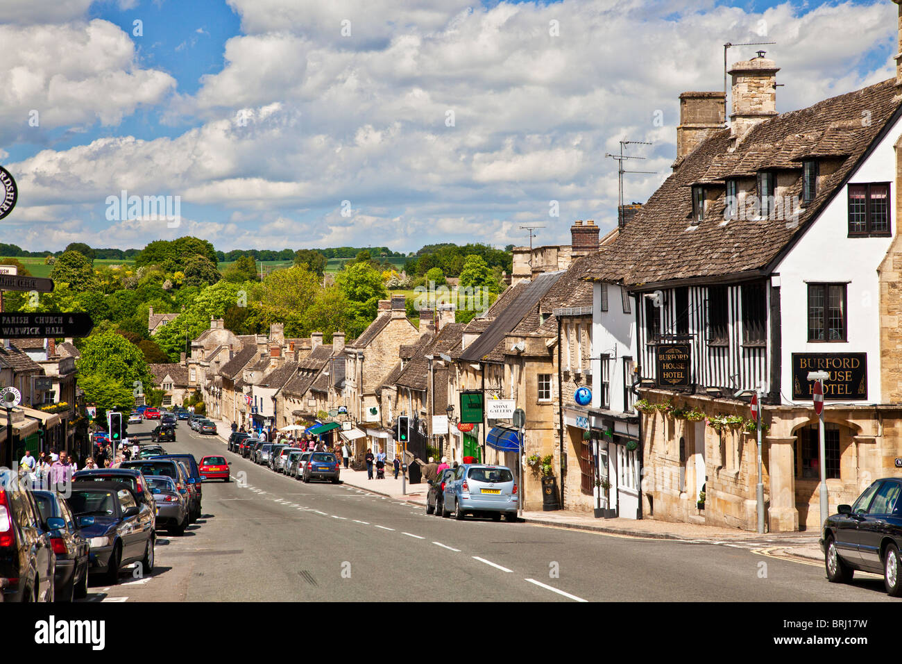 View looking down the High Street in the tourist Cotswold town of Burford, Oxfordshire, England, UK - Stock Image