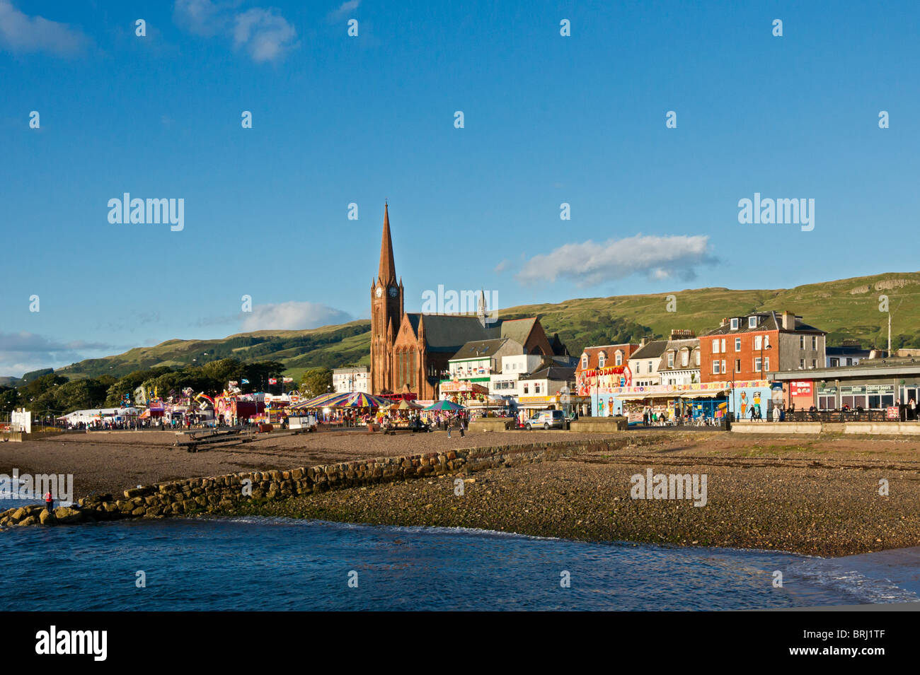 Sea frontage of seaside resort Largs in North Ayrshire Scotland in early evening light - Stock Image