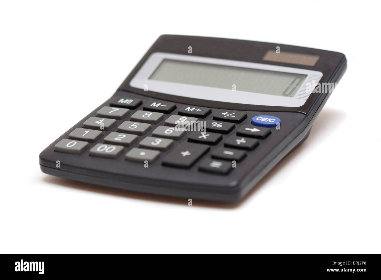 Calculator isolated over white, skew view - Stock Image