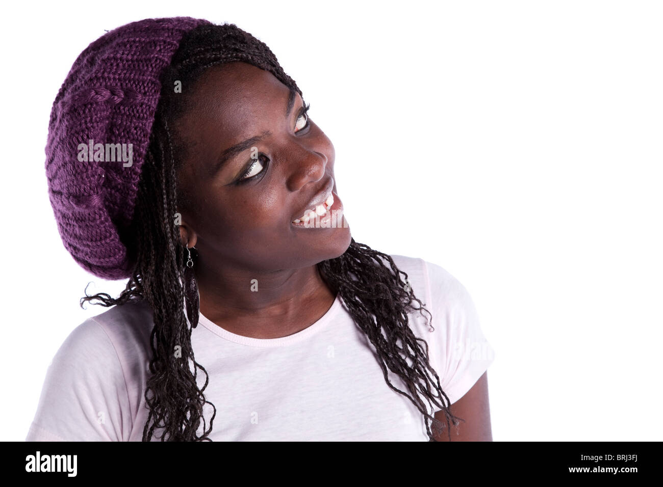 beautiful african woman looking to the copy space (isolated on white) Stock Photo
