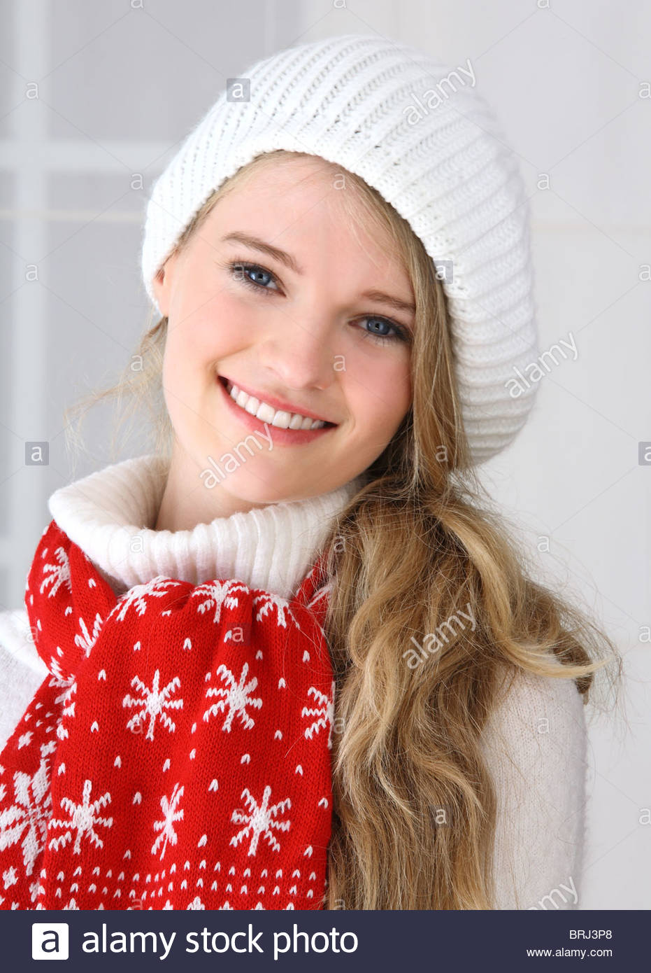 portrait of young woman with red scarf - Stock Image