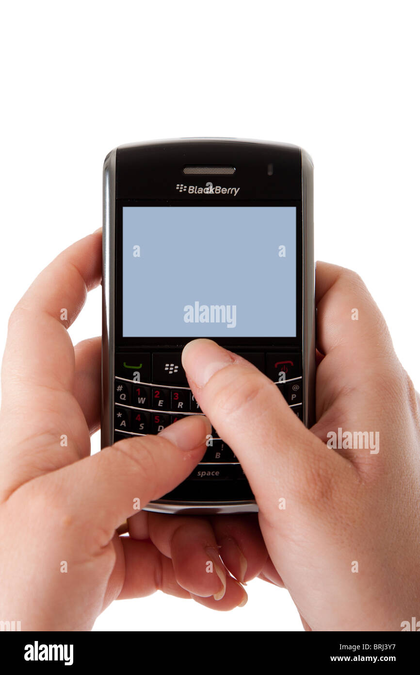 Hands using a Blackberry Bold smartphone computer with blank