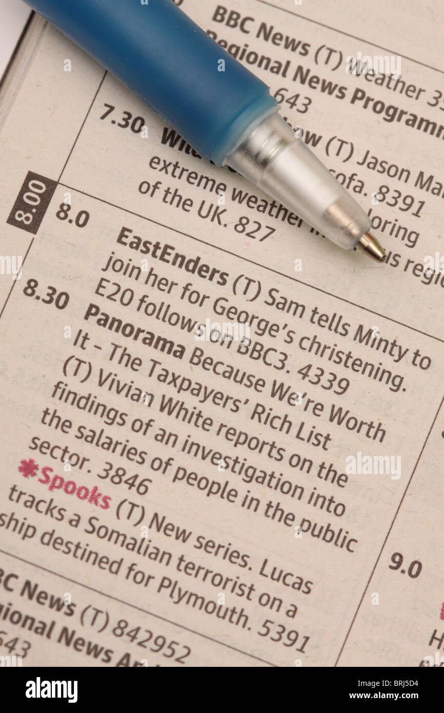TV program listing  showing BBC 1 programs Eastenders and Panorama - Stock Image
